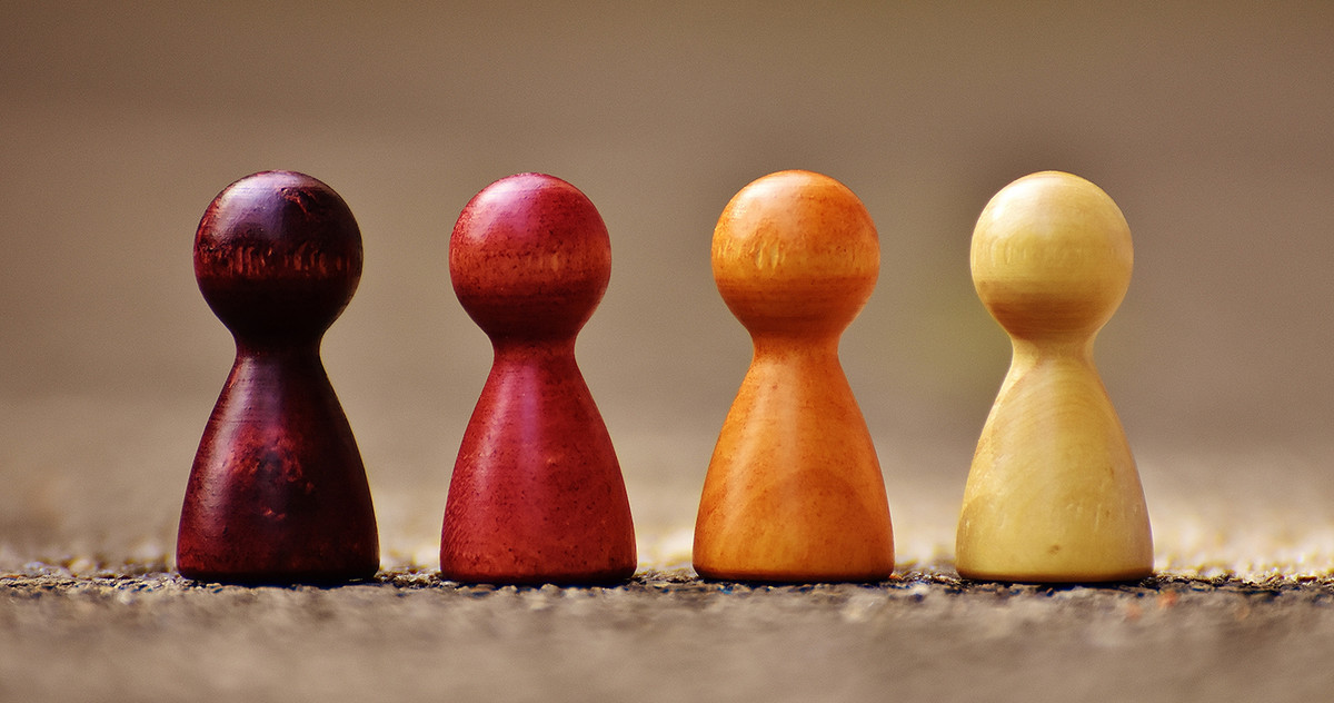 different colored wooden board game figures