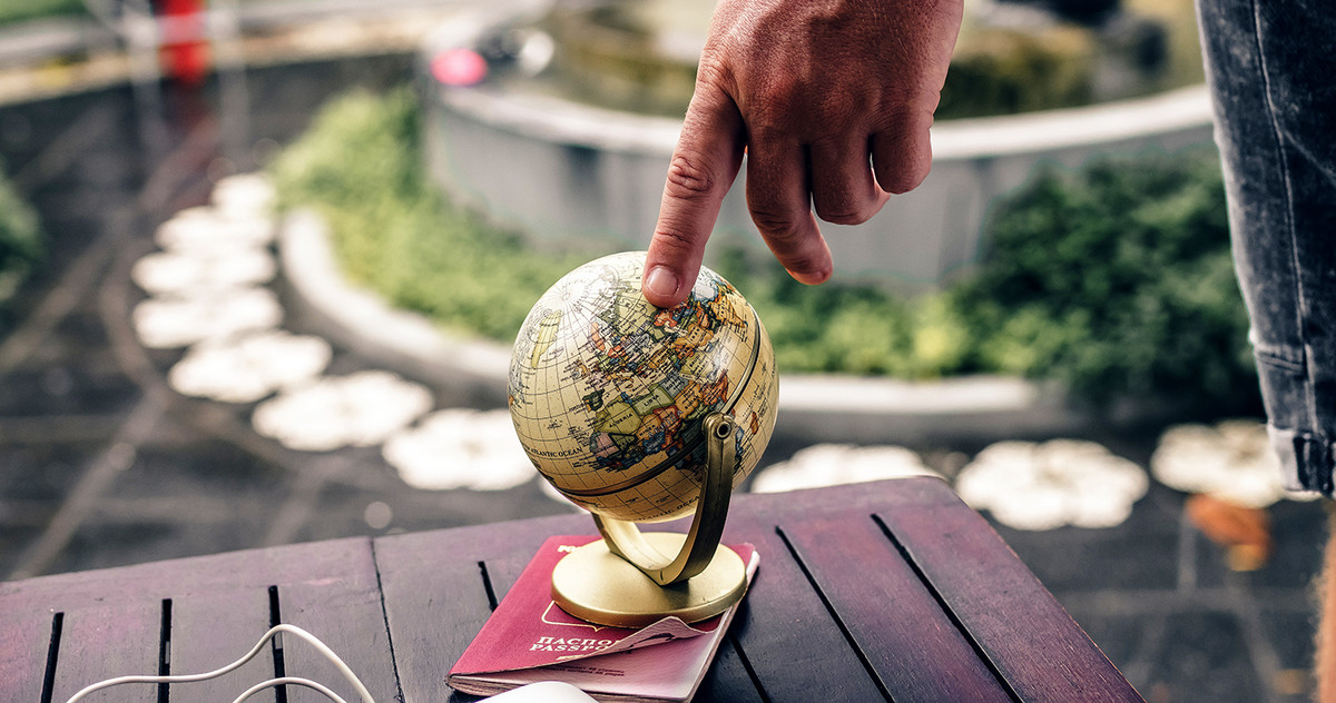 Pic of a CEO pointing at a small globe