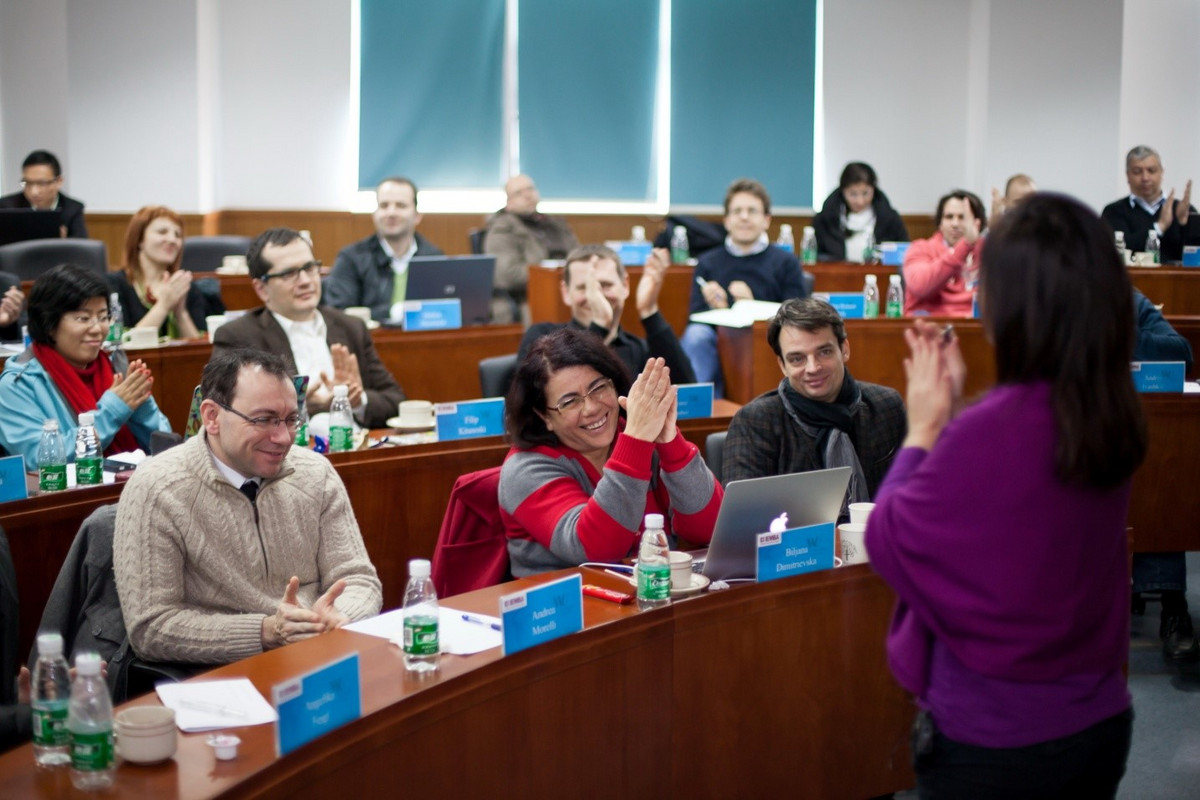 MBA students applauding a professor in class