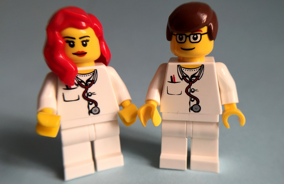 Female and a male Lego figures, both in doctor's outfits
