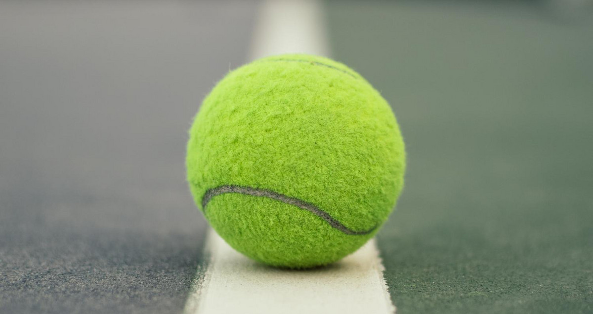 Pic of a tennis ball on the sideline