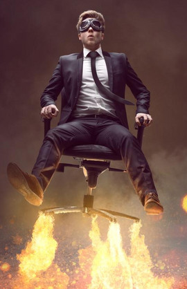 Pic of a MBA graduate flying away on an office chair