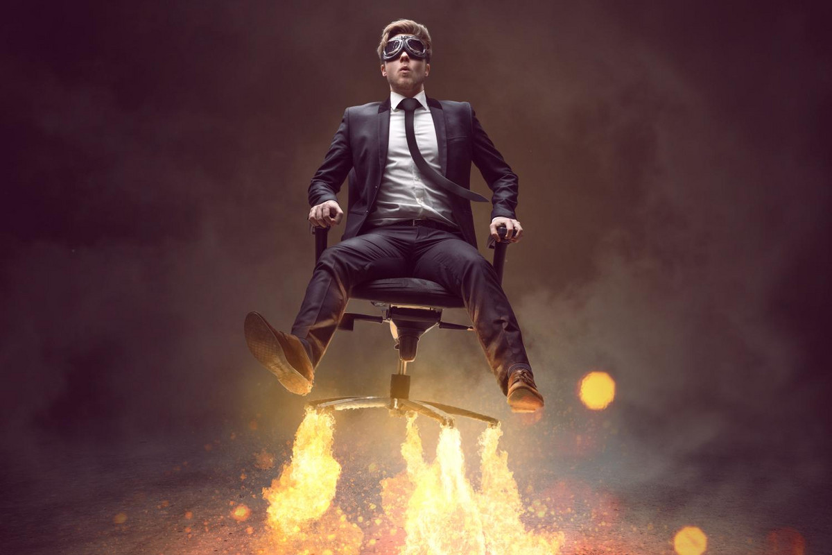 A MBA graduate flying away on an office chair
