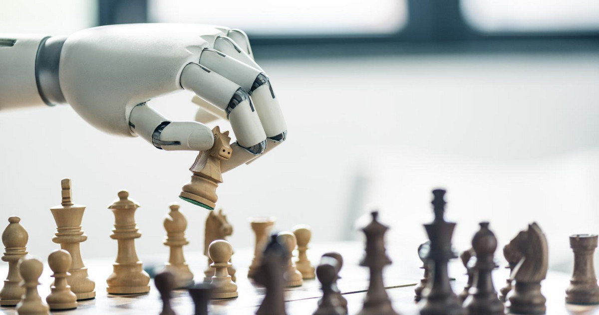 Picture of a robotic hand playing chess