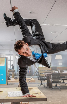 A man breakdancing in the office