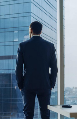 a pmba graduate looking out of his office window