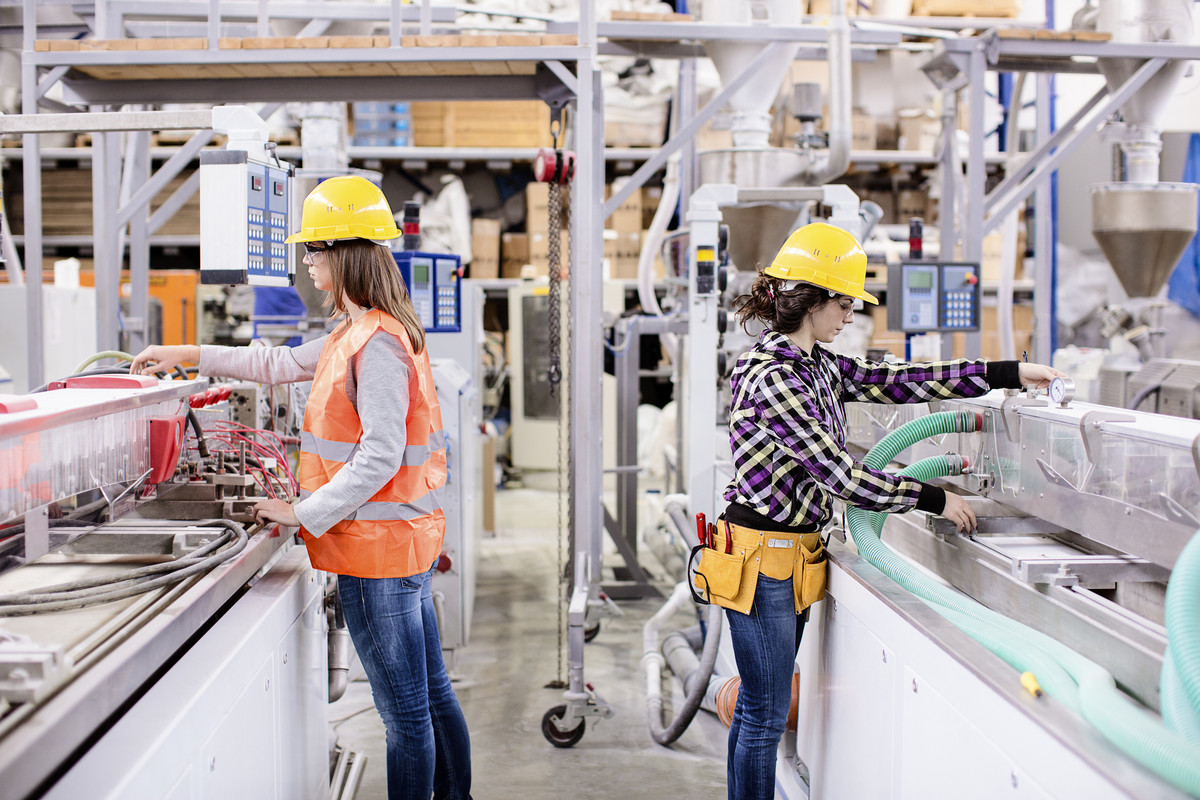 Two girls working in a factory