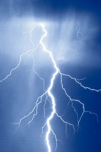a lightning in front of a dark blue background