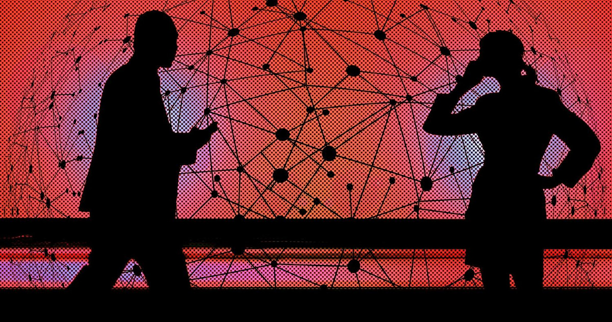 Picture of two silhouettes in front of a symbolized network