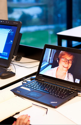 A video conference on a laptop