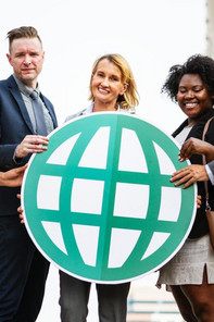 MBA students hold a globe