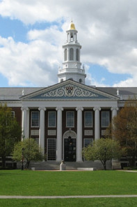 Harvard University building on campus with green grass