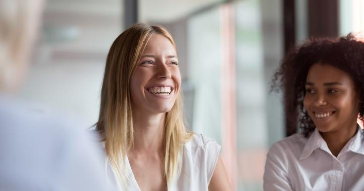 A group of women with MBA degrees is laughing about something